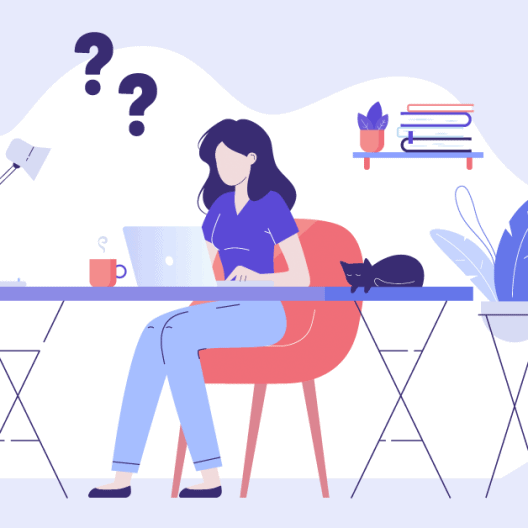 Woman sitting at a desk with question marks